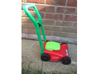 Toy lawn mower and garden trolley