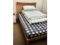 Solid wood small double slatted bed frame and headboard