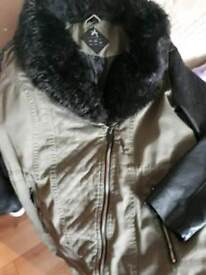 Woman's jacket with fur coller