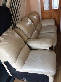 Two cream leather sofas