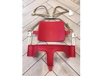 Red Stokke Trip Trapp seat and harness with attachments