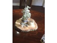 Wedding decorations. Wooden log centre pieces