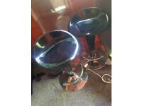 A pair of black bar stools