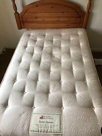 Double divan bed with pine headboard.