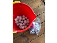 Bucket of golf balls + tees