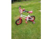 Minnie Mouse bicycle with stabilisers and matching helmet
