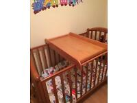 Cot top changing station with shelves