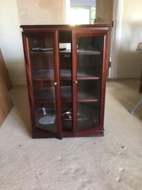 Audio Cabinet for sale. Glass fronted with lid which lifts up