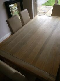 Solid oak dinning table & 6 cream leather chairs