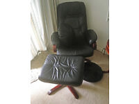 Very comfortable black leather recliner chair with footstool and two cushions.