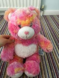 Orange and pink build-a-bear soft toy
