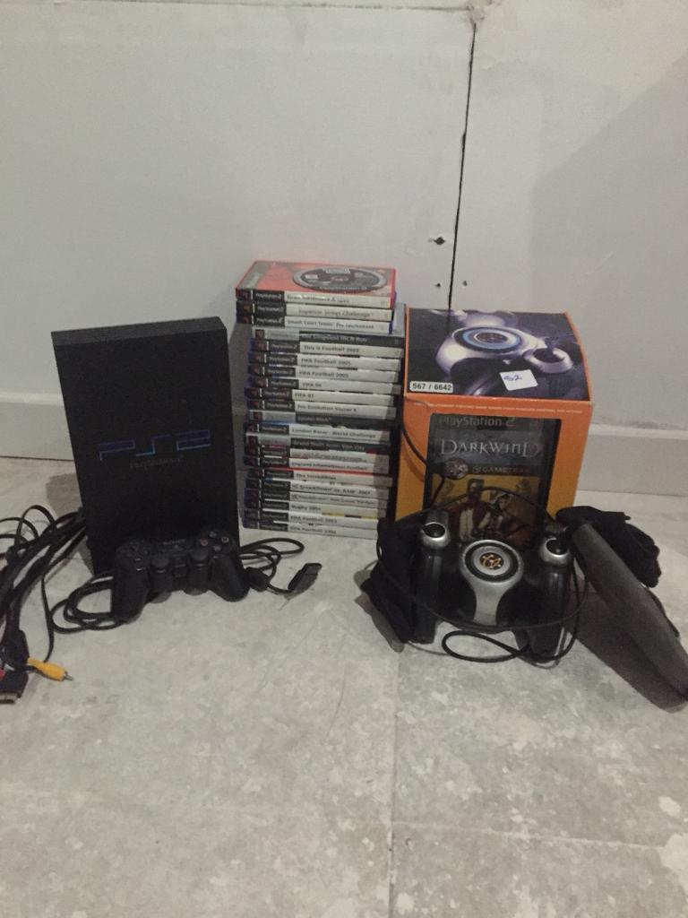 PlayStation 2 with 22 games mint condition