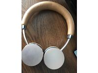 Gold and tan never used goji headphones with bag and charger