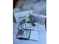 Wii Console, Wii fit board and all accessories in execllent condition