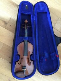 Half size violin with good case