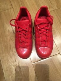 Red Adidas Superstars Trainers