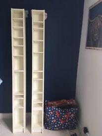 Two Ikea 'Billy' bookshelves in white/cream