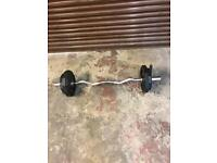Weight training Olympic EZ barbell and weights