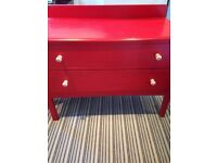 Red two drawer chest of drawers