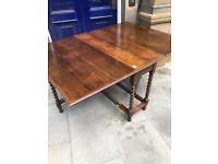Mahogany large drop leaf table , good solid table . Barley twist legs .