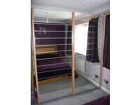 Beech wood double wardrobe with mirror doors. Will come apart for transportation. £100 ovno