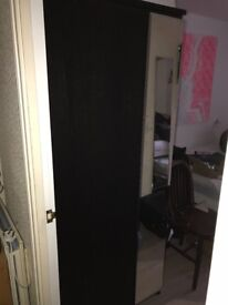 Solid dark brown ikea wardrobe to go by Tuesday