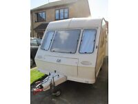 ABBEY SOLITAIRE TWO BERTH CARAVAN with Full Size Awning