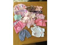 Bundle of dolls clothes and carrier