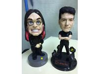 Ozzy osbourne and Simon cowell talking bobble heads