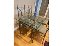 John Lewis glass and silver/steel dining table and chairs plus shelving unit and side table