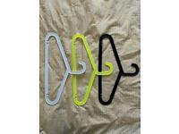 26 plastic clothes hangers