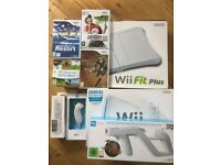 White Wii bundle including games, Wii Fit, 2 controllers and multiple games