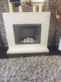 White modern electric fire place with stones