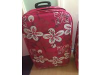 1 medium & 1 large pink flowery suitcases with 2 matching luggage bags