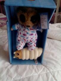Baby Oleg with grub meerkat toy