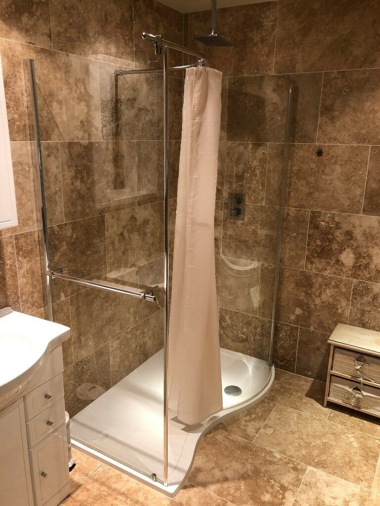 Shower enclosure in white acrylic with two glass panels and towel ...