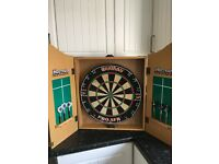 Harrows dart board in cabinet with two sets of darts, good condition