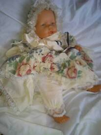 Large plastic doll. Talks crys and face changes.