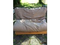 Futon with brown or white mattress/cushion cover in excellent condition.