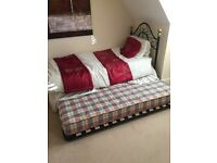 Single bed with a pull out bed underneath