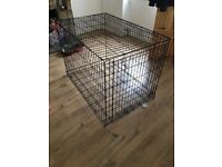 Xxl dog cage used a handful of times come with mat and bowls that connect to the side