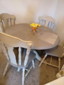 Solid oak table and 4 chairs just needs l alittle TLC