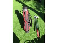Wilson junior golf bag with 5 clubs