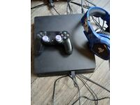 Ps4 slim 1tb with headset,charging dock abd control freeks