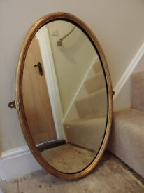 A Gold Oval Antique Mirror