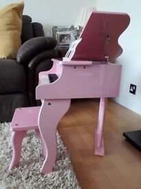 Pink childrens piano with stool