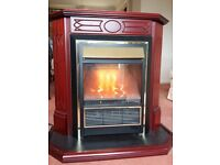 Sunflame II Lullaby electric fan heater in a wood surround with coal and flame effect