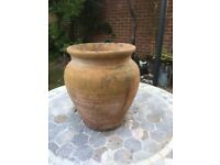 Large curved terracotta pot