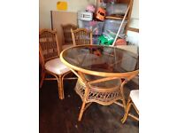 Cane Glass topped table with 4 chairs