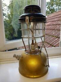Tilley lamp with complete glass.
